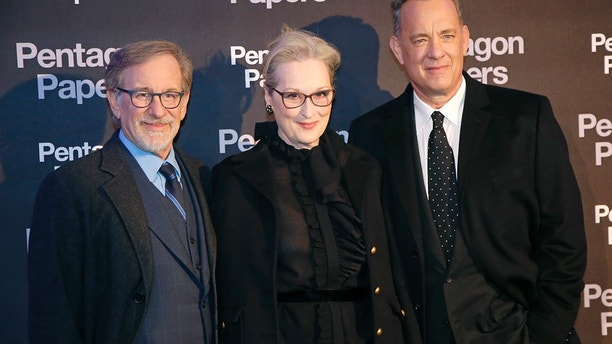 From left, director Steven Spielberg, actors Meryl Streep and Tom Hanks pose for photographers on arrival at the French premiere of the film 'The Post' in Paris, France, Saturday, Jan. 13, 2018. The title of the French version is 'The Pentagon Papers.' (AP Photo/Michel Euler)