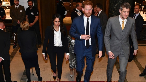 Britain's Prince Harry, centre, and his fiancee US actress Meghan Markle, centre left, arrive to attend the annual Endeavour Fund Awards at Goldsmiths' Hall in London Thursday Feb. 1, 2018.  The royal couple attended the second annual Endeavour Fund Awards ceremony in London, celebrating the sporting and adventure achievements of wounded, injured and sick military veterans as part of their recovery and rehabilitation. (Ben Stansall/pool via AP)