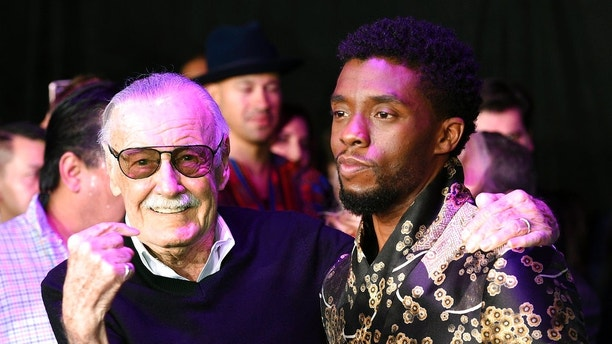 """Comic book legend Stan Lee, left, creator of the """"Black Panther"""" superhero, poses with Chadwick Boseman, star of the new """"Black Panther"""" film, at the premiere at The Dolby Theatre on Monday, Jan. 29, 2018, in Los Angeles. (Photo by Chris Pizzello/Invision/AP)"""