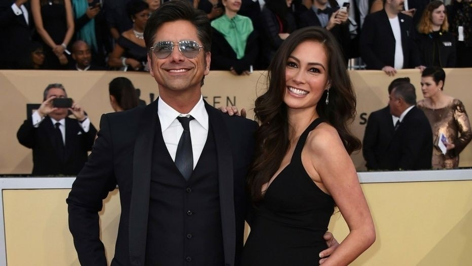 John Stamos and his pregnant fiancee Caitlin McHugh were married Saturday in Beverly Hills, Calif., according to a report.