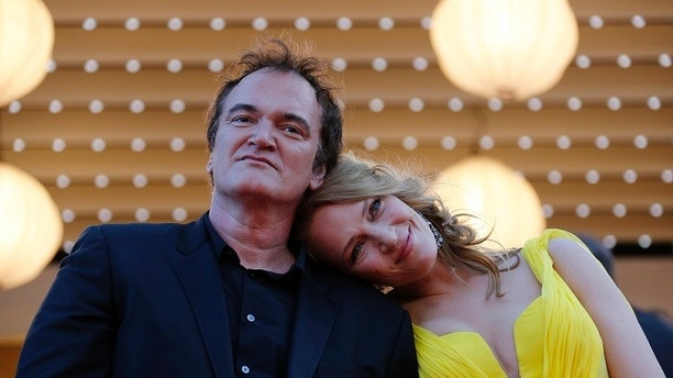 "Director Quentin Tarantino (L) and actress Uma Thurman pose on the red carpet they arrive for the screening of the film ""Sils Maria"" (Clouds of Sils Maria) in competition at the 67th Cannes Film Festival in Cannes May 23, 2014. The film ""Pulp Fiction"" will be presented on Friday during a beach front cinema screening for its 20th anniversary.                     REUTERS/Regis Duvignau (FRANCE  - Tags: ENTERTAINMENT)   - LR2EA5N1B42H9"