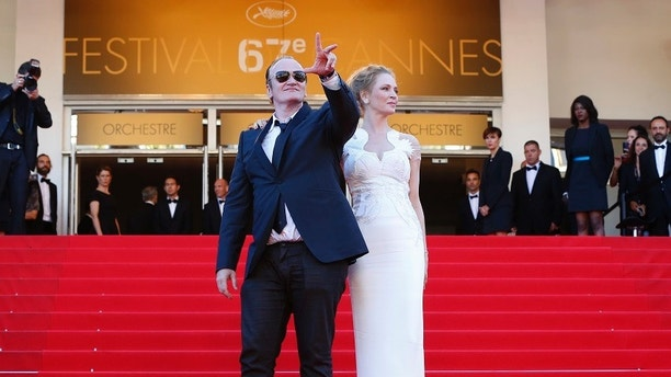 Director Quentin Tarantino (L) and actress Uma Thurman pose on the red carpet as they arrive at the closing ceremony of the 67th Cannes Film Festival in Cannes May 24, 2014.                REUTERS/Yves Herman (FRANCE  - Tags: ENTERTAINMENT)   - LR2EA5O1MS0LR