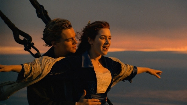 "This image released by Paramount Pictures shows Leonardo DiCaprio, left, and Kate Winslet in a scene from ""Titanic.""  The film will be returning to theaters for one week. Dolby Laboratories, Paramount Pictures and AMC Theaters said Wednesday, Nov. 15, 2017, that a re-mastered version of the James Cameron film will be shown at select AMC locations nationwide starting Dec. 1. Cameron says it is the best-looking version of ""Titanic"" ever released. (Paramount Pictures via AP)"