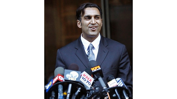 Defendant doctor Sandeep Kapoor talks to the media outside the Los Angeles County Criminal Courts building in Los Angeles October 28, 2010. A jury acquitted Kapoor of all charges that he illegally supplied Anna Nicole Smith with prescription drugs for years before her death from an accidental overdose. REUTERS/Mario Anzuoni (UNITED STATES - Tags: ENTERTAINMENT CRIME LAW) - GM1E6AT0L6I01