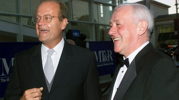 Actor Kelsey Grammer talks with John Mahoney at the Museum of Television & Radio Annual Gala which honored Grammer in Beverly Hills on September 24, 2000.