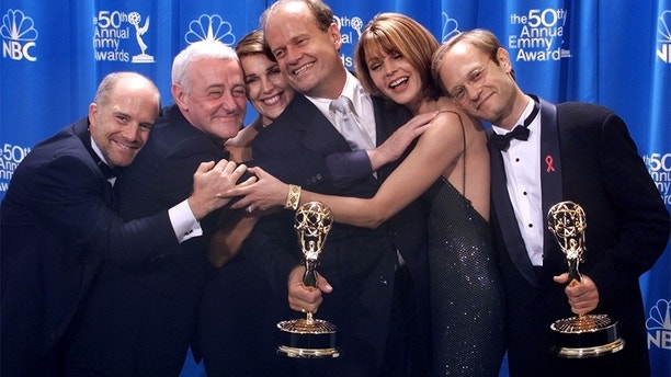 "The cast of the sitcom ""Frasier,"" (L-R) Dan Butler, John Mahoney, Peri Gilpin, Kelsey Grammer, Jane Leeves, and David Hyde Pierce, poses backstage at the 50th Annual Emmy Awards in Los Angeles on September 13. The series broke an Emmy record by winning for the fifth time.