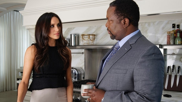 "SUITS -- ""Donna"" Episode 710 -- Pictured: (l-r) Meghan Markle as Rachel Zane, Wendell Pierce as Robert Zane -- (Photo by: Ben Mark Holzberg/USA Network)"