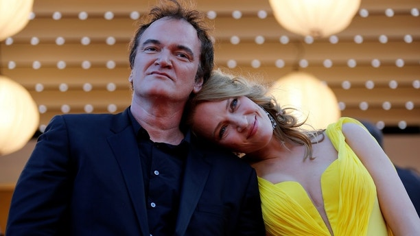 "FILE PHOTO:    Director Quentin Tarantino (L) and actress Uma Thurman pose on the red carpet they arrive for the screening of the film ""Sils Maria"" (Clouds of Sils Maria) in competition at the 67th Cannes Film Festival in Cannes May 23, 2014. The film ""Pulp Fiction"" will be presented on Friday during a beach front cinema screening for its 20th anniversary.                      REUTERS/Regis Duvignau/File Photo - RC12E1EECFD0"