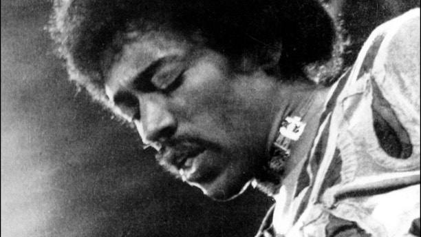 ** FILE ** This is a 1970 file photo of rock and roll guitarist Jimi Hendrix performing on the Isle of Wight in England.  Technicians at Sweden's public television have unearthed an unexpected delight for music lovers _ a complete original recording of a Jimi Hendrix concert in Stockholm from 1969 on a tape long thought to have been destroyed. (AP Photo/File)