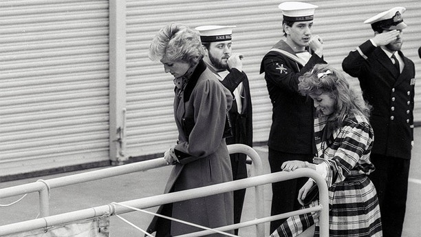 Princess Diana (L) and Sarah Ferguson board the HMS Brazen, which is moored in the pool of London on February 5, 1986. They were shown around the ship by Prince Andrew who is a helicopter pilot attached to HMS Brazen. Miss Ferguson is reputed to be the girlfriend of Prince Andrew.     REUTERS/J. Eggitt - GF2DUDTHKGAB