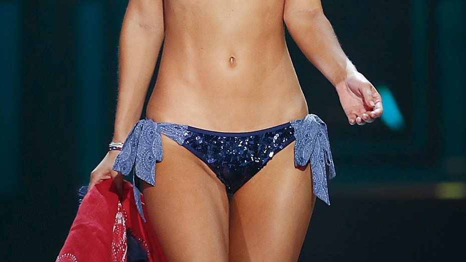 Miss USA Olivia Jordan walks on stage in a swimsuit during the 2015 Miss USA beauty pageant in Baton Rouge, Louisiana July 12, 2015. Fifty-one state titleholders compete in the swimsuit, evening gown and interview categories for the title of Miss USA 2015.