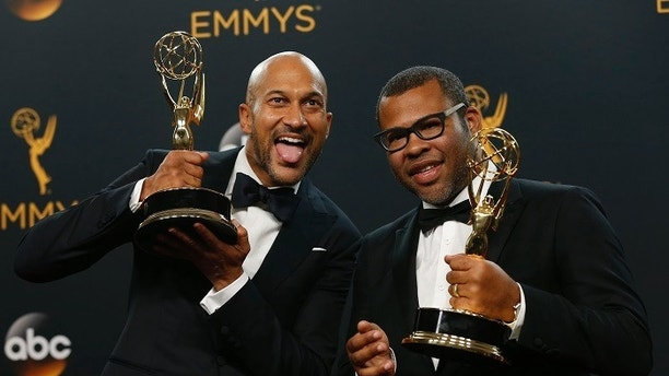"Keegan-Michael Key (L) and Jordan Peele pose backstage with their award for Outstanding Variety Sketch Series for ""Key & Peele"" at the 68th Primetime Emmy Awards in Los Angeles, California U.S., September 18, 2016.  REUTERS/Mario Anzuoni - HT1EC9J0B5Z8S"