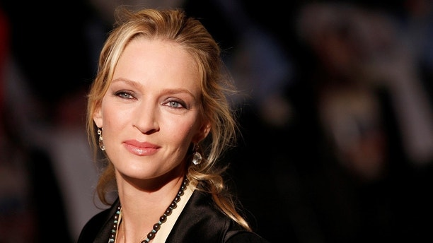 "U.S. actress Uma Thurman arrives for the British premiere of ""The Accidental Husband"" in London's Leicester Square February 13, 2008.    REUTERS/Stephen Hird   (BRITAIN) - GM1DXGJXEAAA"