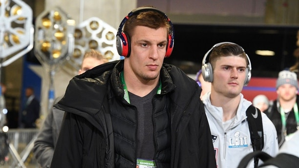 Feb 4, 2018; Minneapolis, MN, USA; New England Patriots tight end Rob Gronkowski (middle) arrives at U.S. Bank Stadium before Super Bowl LII against the Philadelphia Eagles. Mandatory Credit: Kirby Lee-USA TODAY Sports - 10587237