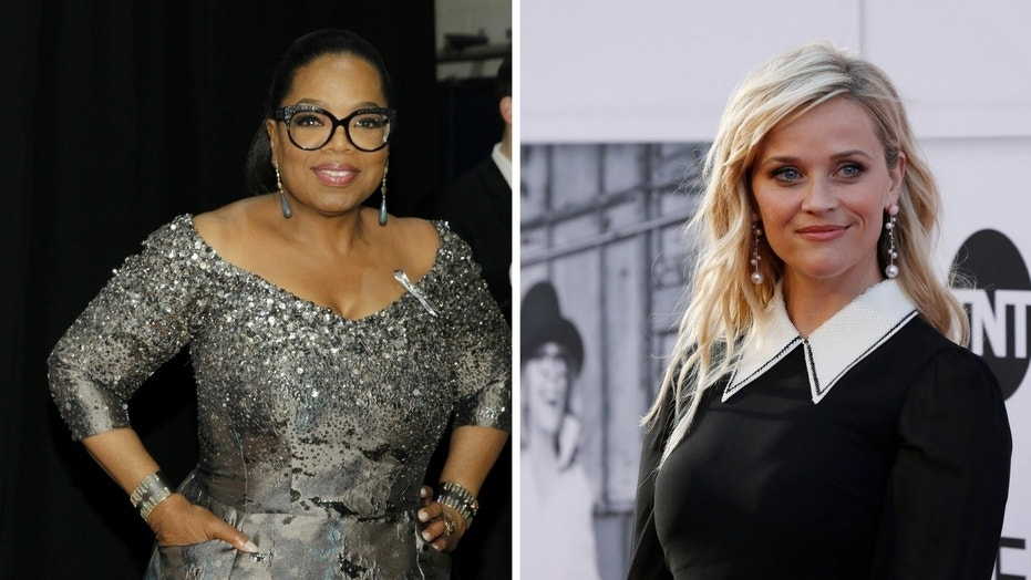 Oprah Winfrey said Reese Witherspoon showed signs of PTSD following the mention of disgraced producer Harvey Weinstein.