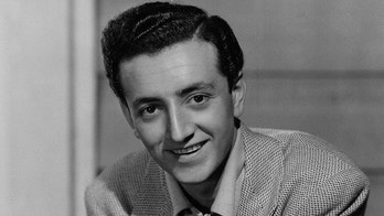 Vic Damone, teenage radio singing star, is seen, Dec. 1947.  (AP Photo)