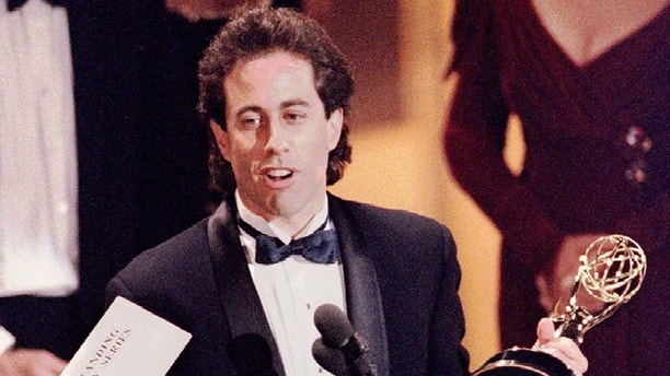 FILE PHOTO 19SEP93 - After a stunningly successful nine-year run, comedian Seinfeld has decided to stop production of his quirky hit television show at the end of this season in May, NBC said on December 26. Seinfeld holds the Emmy award for outstanding comedy series at the 45th annual Emmy Awards telecasting in this September 19, 1993 file photo.