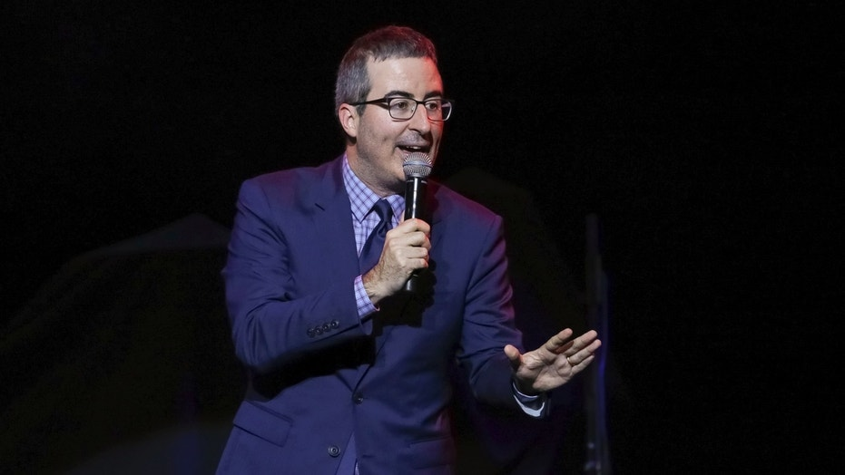 FILE - In this Nov. 7, 2017 file photo, comedian John Oliver performs at the 11th Annual Stand Up for Heroes benefit in New York. Oliver's show, which begins its fifth season on Sunday. (Photo by Brent N. Clarke/Invision/AP, File)