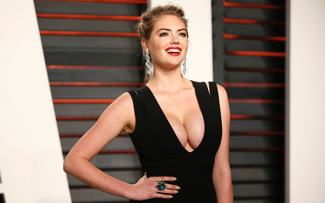 Topless Kate Upton swept off jagged rock by huge wave during SI Swim shoot