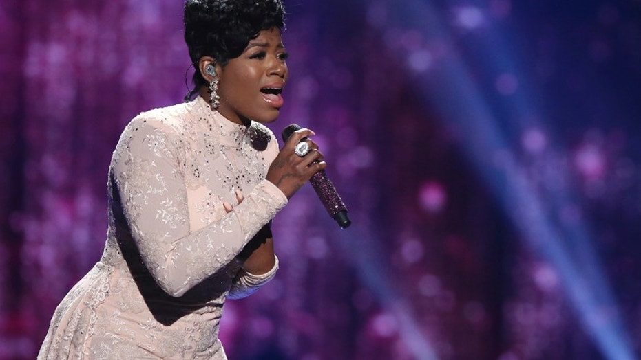 "In this April 7, 2016, file photo, Fantasia Barrino performs at the ""American Idol"" farewell season finale at the Dolby Theatre in Los Angeles. Barrino canceled a scheduled concert in Memphis, Tenn., on March 5, 2017, due to what her husband said were second degree burns she suffered in an accident."