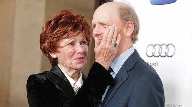 "Director and actor Ron Howard,Hall of Fame inductee, poses with his former TV co-star Marion Ross from their series ""Happy Days"" at the Academy of Television Arts & Sciences 22nd annual Hall of Fame gala in Beverly Hills, California March 11, 2013. REUTERS/Fred Prouser (UNITED STATES - Tags: ENTERTAINMENT) - GM1E93C0X1R01"