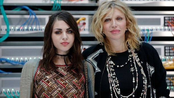 Musician Courtney Love (R) and her daughter and producer Frances Bean Cobain pose during a photocall before the Spring/Summer 2017 women's ready-to-wear collection for fashion house Chanel during Fashion Week in Paris, France October 4, 2016. REUTERS/Gonzalo Fuentes - D1BEUFACIYAB