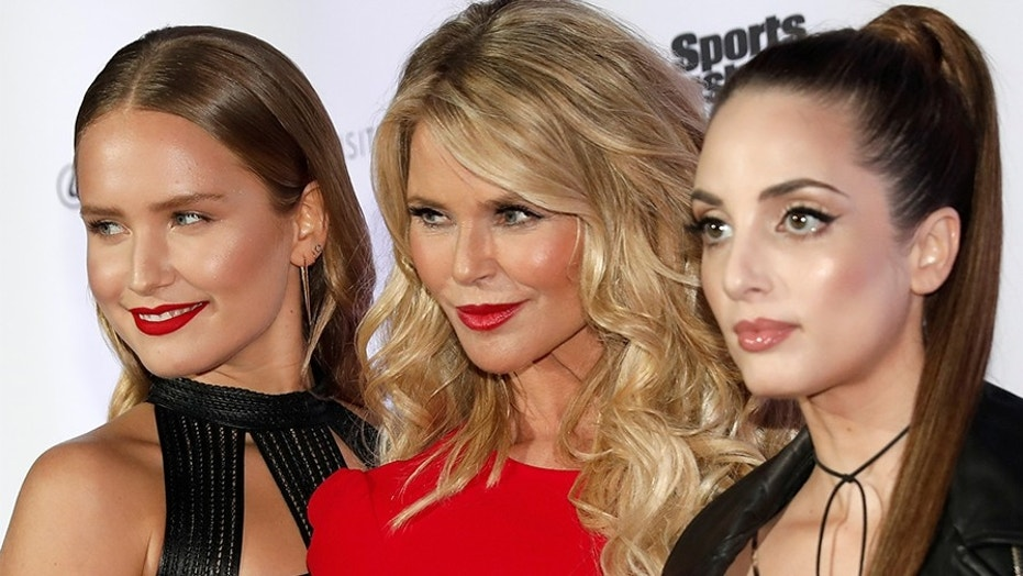 Christie Brinkley (C) and her daughters Sailor Brinkley Cook (L) and Alexa Ray Joel (R) pose for photographers at a launch event for the Swimsuit Issue in New York City, U.S., February 16, 2017