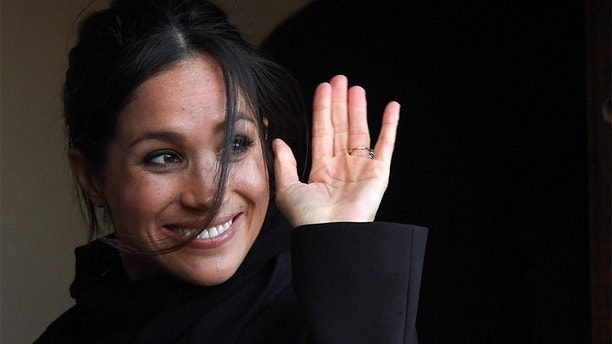 Meghan Markle greets well-wishers during a visit to Cardiff Castle with her fiancee Britain's Prince Harry in Cardiff, Britain, January 18, 2018. REUTERS/Toby Melville - RC1A273F0ED0