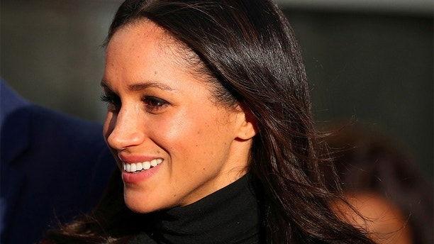 Meghan Markle leaves after visiting a school with her fiancee Britain's Prince Harry in Nottingham, December 1, 2017. REUTERS/Hannah McKay - RC154DC1AA20