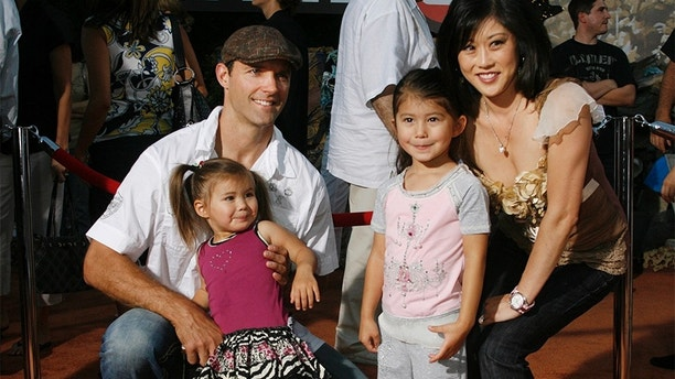 "Olympic figure skating champion Kristi Yamaguchi (R) poses with husband Bret Hedican (L) and daughters Emma  (2nd L) and Keara at the world premiere of Disney-Pixar's film ""Wall-E"" in Los Angeles, California June 21, 2008. The film opens June 27, 2008.  REUTERS/Fred Prouser                   (UNITED STATES) - GM1E46M168R01"