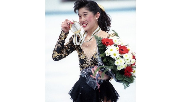 U.S.A's Olympic figure skater Kristi Yamaguchi, 21, of San Francisco, Ca., shows off her gold medal in Albertville on February 21, 1992. Yamaguchi's compatriot Nancy Kerrigan win the Bronze medal.   REUTERS/Michael Probst - GF2DTMTKOTAA