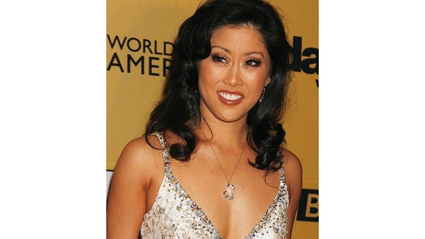"Contestant Kristi Yamaguchi poses at the ""Dancing with the Stars"" 100th show party in Hollywood, California May 6, 2008.    REUTERS/Fred Prouser                     (UNITED STATES) - GM1E45714FD01"