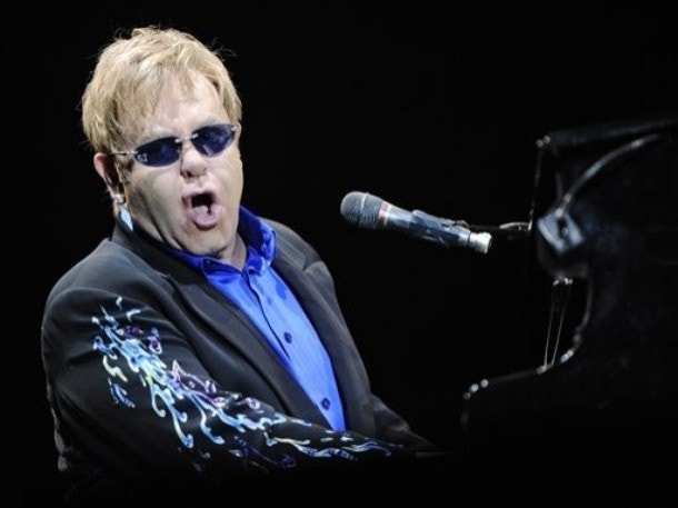 Elton John silenced after fan throws Mardi Gras beads at his mouth during performance