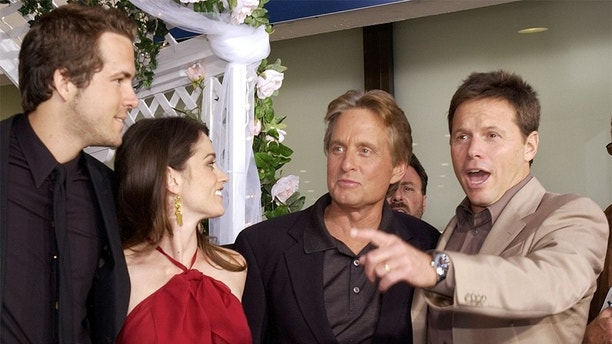 Producer Bill Gerber (R) chates with cast members (L-R) Ryan Reynolds,