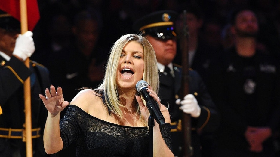 Singer Fergie performs the national anthem prior to an NBA All-Star basketball game, Sunday, Feb. 18, 2018, in Los Angeles.