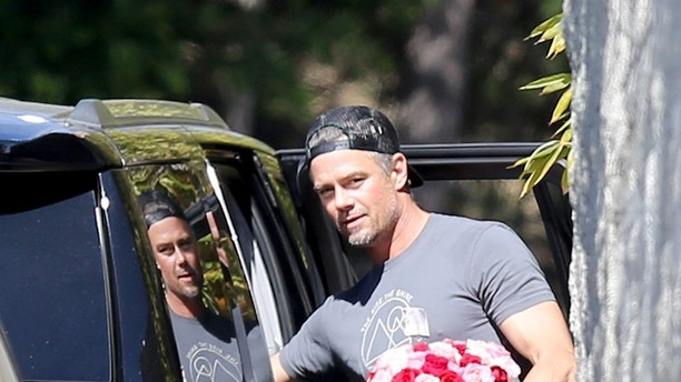 Josh Duhamel carries red and white flowers to Fergies home in Brentwood after her much ridiculed performance of the National Anthem. <P> Pictured: Josh Duhamel and Axl <B>Ref: SPL1661551 190218 </B><BR/> Picture by: / Splash News<BR/> </P><P> <B>Splash News and Pictures</B><BR/> Los Angeles:310-821-2666<BR/> New York:212-619-2666<BR/> London:870-934-2666<BR/> photodesk@splashnews.com<BR/> </P>
