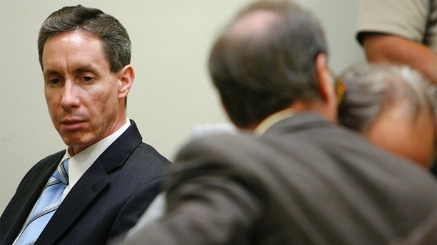 "Warren Jeffs (L) looks at his attorney during his trial in St. George, Utah, September 19, 2007. A Utah judge rejected a motion to dismiss charges against a self-described ""prophet"" of a breakaway Mormon sect that practices polygamy after prosecutors rested their case unexpectedly early on Tuesday. Warren Jeffs, 51, the leader of the Fundamentalist Church of Jesus Christ of Latter Day Saints, is on trial on two counts of being an accomplice to rape after he presided over a wedding of a 14-year-old girl. REUTERS/Trent Nelson/Pool  (UNITED STATES) - GM1DWEPNJXAA"