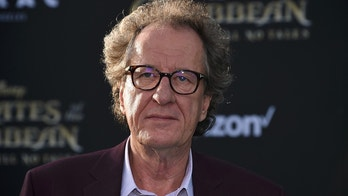 "The Premiere of Disney's ""Pirates of the Caribbean: Dead Men Tell No Tales""  – Los Angeles, California, U.S., 18/05/2017 - Actor Geoffrey Rush signs autographs. REUTERS/Phil Mccarten - HP1ED5J04K8IM"