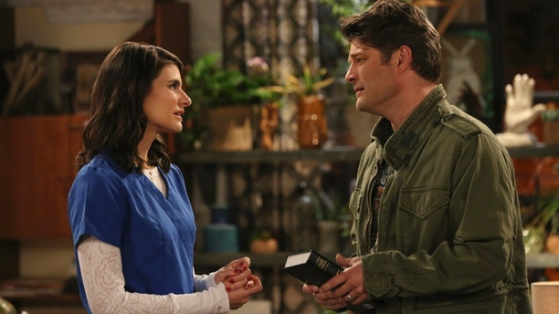 Pilot -- Upon learning that Lesley is expecting, Chip goes to the bookstore seeking parenting guidance, and stumbles upon a bible which inspires him to begin living strictly by the book, on the series premiere of LIVING BIBLICALLY, Monday, Feb 26 (9:30-10:00 PM, ET/PT) on the CBS Television Network.  Pictured L-R: Lindsey Kraft as Lesley and Jay R. Ferguson as Chip Photo: Michael Yarish/CBS ©2017 CBS Broadcasting, Inc. All Rights Reserved