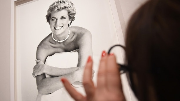 An image of Princess Diana is inspected at the press preview for 'Vogue 100: A Century of Style' exhibiting the photographs that has been commissioned by British Vogue since it was founded in 1916 at National Portrait Gallery on February 10, 2016 in London, England.