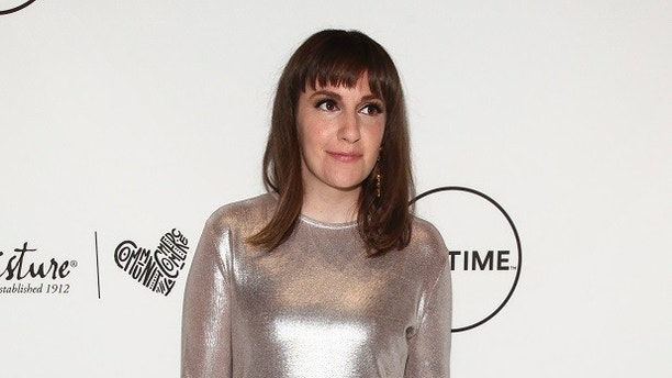FILE - In this April 21, 2017 file photo, Lena Dunham attends Variety's Power of Women event in New York. Dunham has written an incredibly personal essay about coming to terms with permanent infertility at age 31. Vogue.com published Dunham's detailed account Wednesday of her decision to undergo a hysterectomy late last year to relieve what she describes as debilitating pain from endometriosis. (Photo by Andy Kropa/Invision/AP, File)