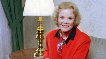 "FILE - In this April 18, 1997 file photo, actress Nanette Fabray, co-star of the off-Broadway comedy ""Bermuda Avenue Triangle,"" poses in her hotel room in New York. Fabray, the vivacious, award-winning star of the stage, film and television, has died at age 97. Fabray's son, Dr. Jamie MacDougall, tells The Associated Press his mother died Thursday, Feb. 22, 2018, at her home in Palos Verdes Estates, Calif. (AP Photo/Rich Maiman, File)"