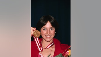 (Original Caption) Innsbruck: Dorothy Hamill of Riverside, Conn. with her gold medal won in Olympic figure skating.