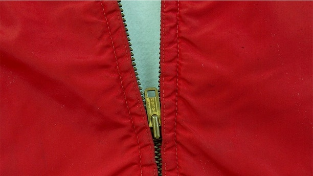 "In this, Monday, Feb. 12, 2018, photo, the zipper on a jacket worn by actor James Dean in the film ""Rebel Without a Cause,"" is viewed at Palm Beach Modern Auctions in West Palm Beach, Fla. The jacket, privately owned since Dean wore it in the 1955 film, will be publicly auctioned in Florida on March 3. (AP Photo/Wilfredo Lee)"