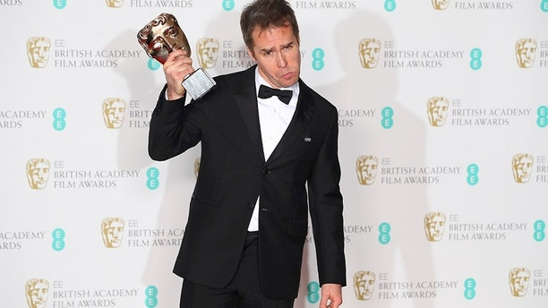 Sam Rockwell holds his award for Supporting Actor for Three Billboards Outside Ebbing Missouri at the British Academy of Film and Television Awards (BAFTA) at the Royal Albert Hall in London, Britain, February 18, 2018. REUTERS/Hannah McKay     TPX IMAGES OF THE DAY - RC1BDBB565B0