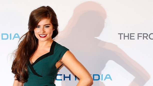 """Actress Rachel Shenton poses at the UK Premiere of """"The Frozen Ground"""" at Leicester Square in London July 17, 2013. REUTERS/Stefan Wermuth  (BRITAIN - Tags: ENTERTAINMENT) - GM1E97I08UM01"""
