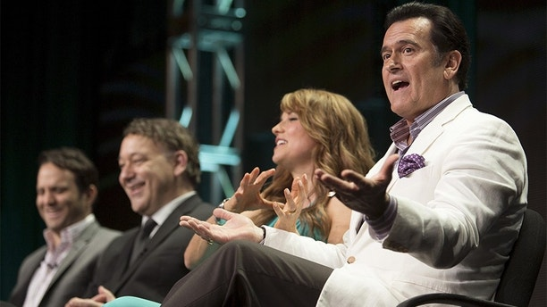 "Actor Bruce Campbell speaks, joined by showrunner Craig DiGregorio (L), director/executive producer Sam Raimi and actress Lucy Lawless, during the Starz ""Ash vs Evil Dead"" panel at the Television Critics Association (TCA) Summer 2015 Press Tour in Beverly Hills, California July 31, 2015.   REUTERS/David McNew   - GF20000010335"