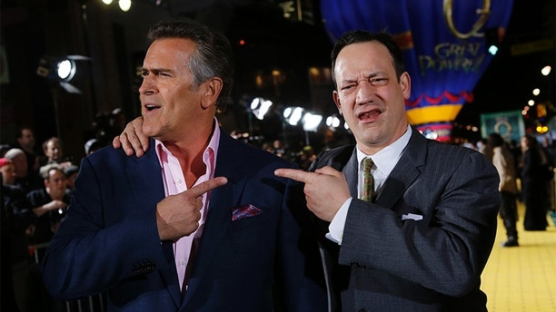 "(L-R) Actors Bruce Campbell and Ted Raimi share a light moment at the premiere of the Disney movie ""Oz the Great and Powerful"" at the El Capitan Theatre in Hollywood, California February 13, 2013. REUTERS/Patrick Fallon (UNITED STATES - Tags: ENTERTAINMENT) - GM1E92E1GJN01"