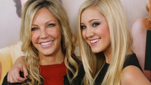 """Actress Heather Locklear and cast member Ava Sambora (R) arrive at the premiere of the movie """"This is 40"""" at Grauman's Chinese Theatre in Hollywood, California December 12, 2012."""