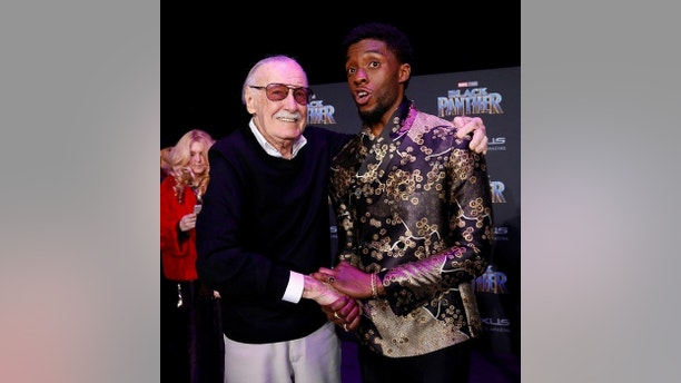 """Stan Lee (L) poses with cast member Chadwick Boseman at the premiere of """"Black Panther"""" in Los Angeles, California, U.S., January 29, 2018. REUTERS/Mario Anzuoni - RC1B94C86960"""